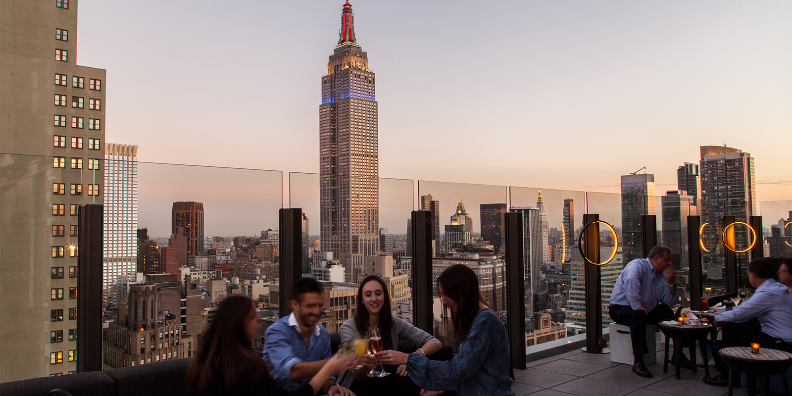 group enjoying cocktails on the rooftop