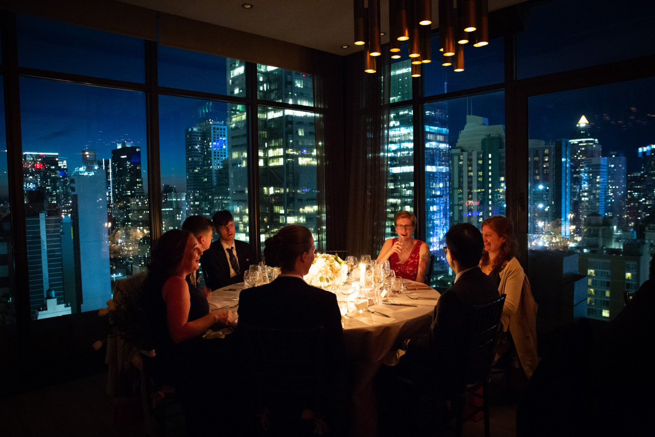 guests at their table in front of the night sky