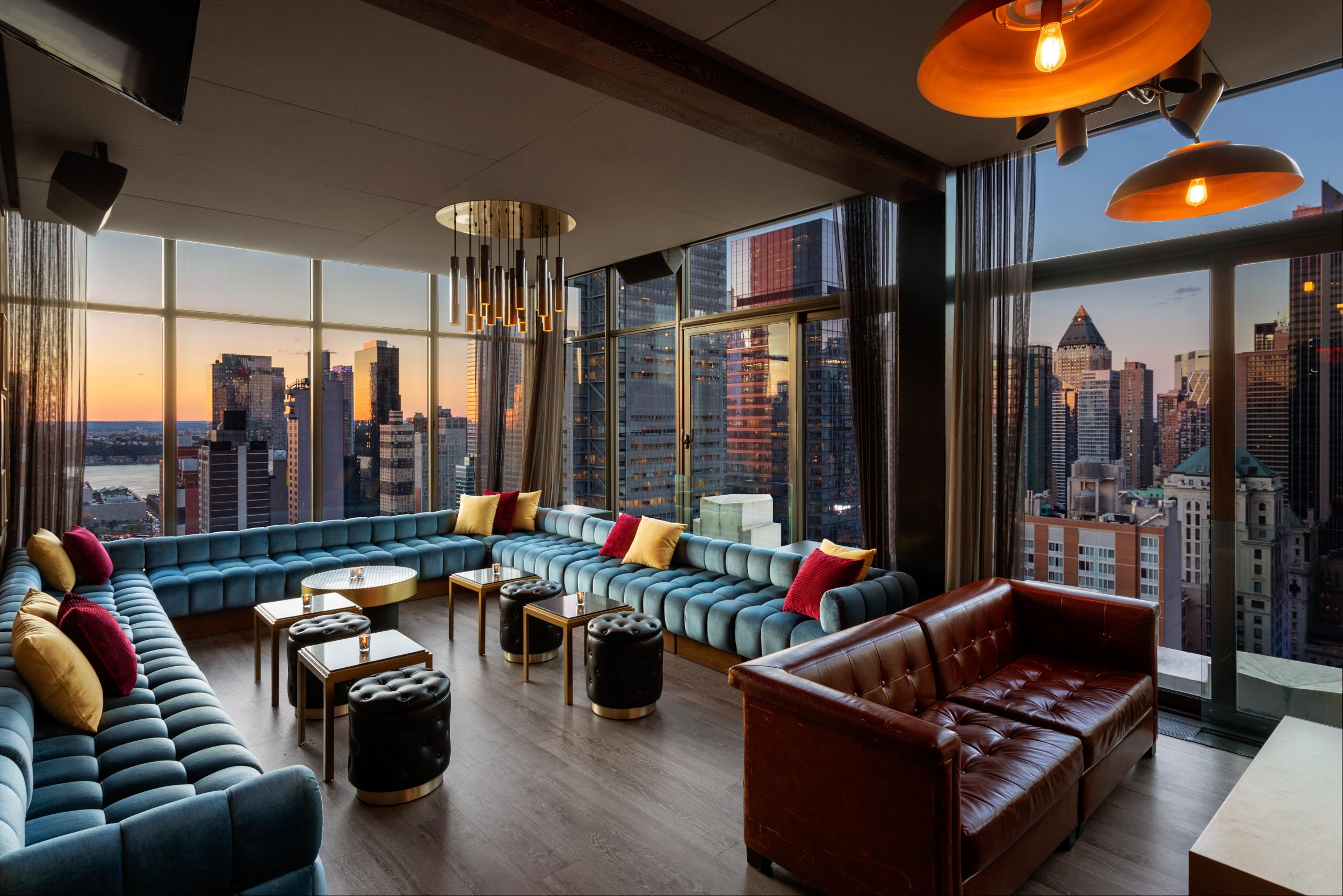 skylark main lounge with sunset city views